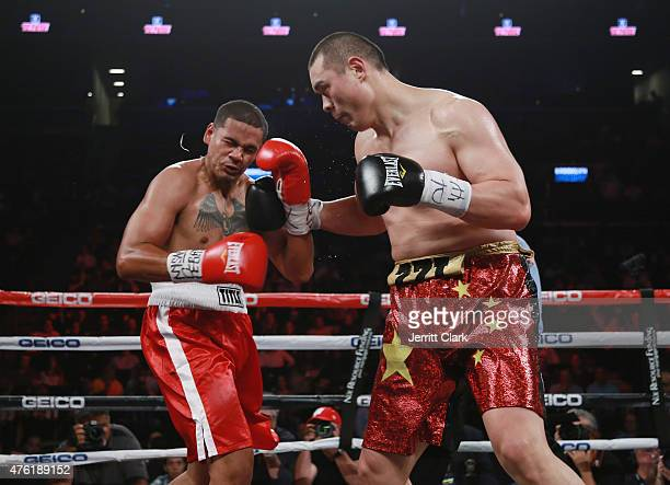 Zhang Zhilei punches Glenn Thomas during their heavyweight fight at Barclays Center on June 6 2015 in the Brooklyn borough of New York City