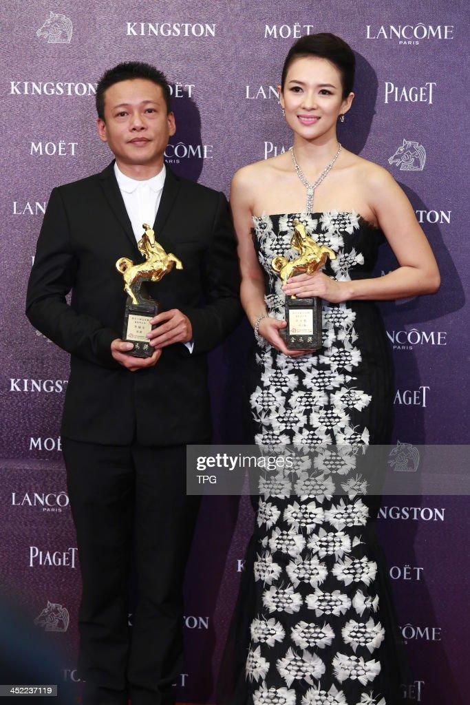 Zhang Ziyi and Li Kangsheng pose for camera at the 50th Golden Horse Awards on Saturday November 23,2013 in Taipei,China.
