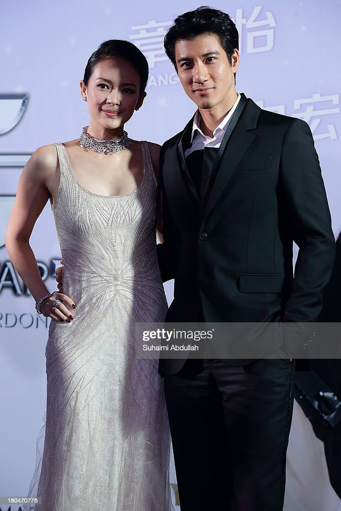 Zhang Ziyi and Wang Lee Hom pose for a photo during the red carpet event of the gala premiere of 'My Lucky Star' at The Shoppes at Marina Bay Sands on September 13, 2013 in Singapore.