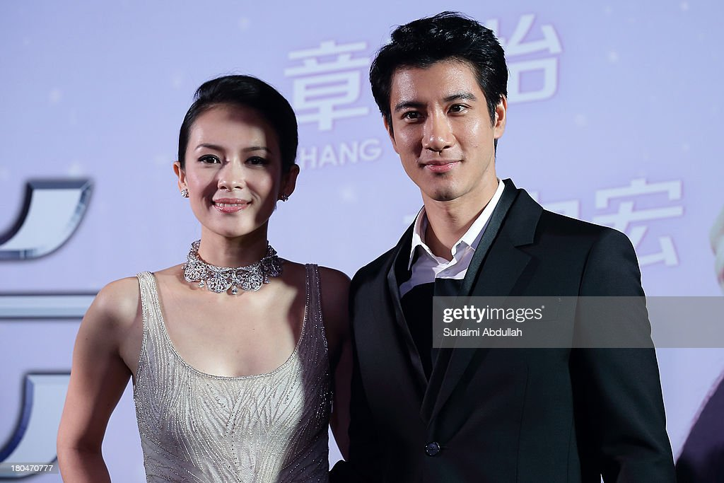 <a gi-track='captionPersonalityLinkClicked' href=/galleries/search?phrase=Zhang+Ziyi&family=editorial&specificpeople=172013 ng-click='$event.stopPropagation()'>Zhang Ziyi</a> and Wang Lee Hom pose for a photo during the red carpet event of the gala premiere of 'My Lucky Star' at The Shoppes at Marina Bay Sands on September 13, 2013 in Singapore.