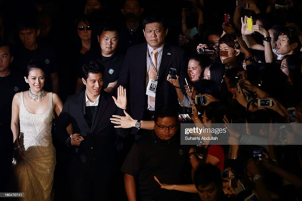 Zhang Ziyi and Wang Lee Hom walk the red carpet during the gala premiere of My Lucky Star at The Shoppes at Marina Bay Sands on September 13, 2013 in Singapore.