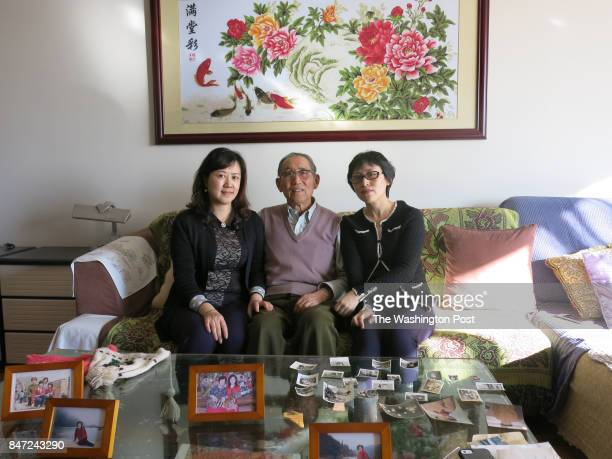 Zhao Hongxi sits with his two daughters Zhao Wei and Zhao Yan in his apartment in Beijing on Jan 20 2017 Zhaos wife Lu Wen died on January and the...