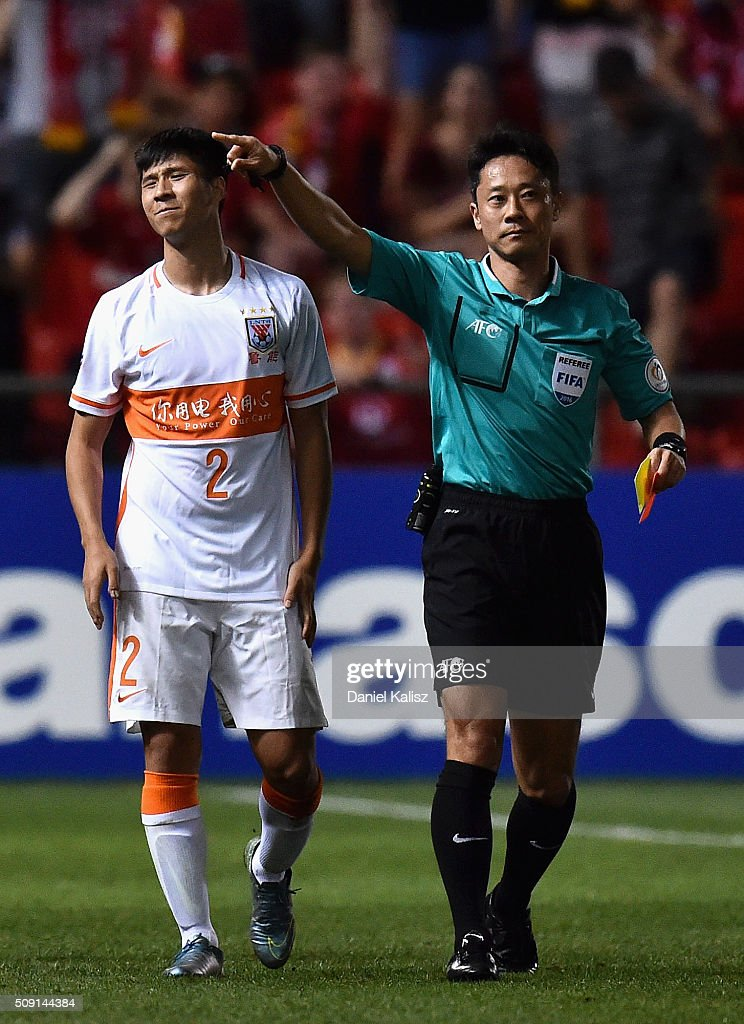 Zhao Mingjian of Shandong Luneng is sent off after receiving the red card by the referee during the AFC Champions League playoff match between Adelaide United and Shandong Luneng at Coopers Stadium on February 9, 2016 in Adelaide, Australia.