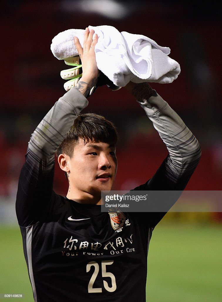 Zhao Mingjian of Shandong Luneng reacts to the crowd after the AFC Champions League playoff match between Adelaide United and Shandong Luneng at Coopers Stadium on February 9, 2016 in Adelaide, Australia.