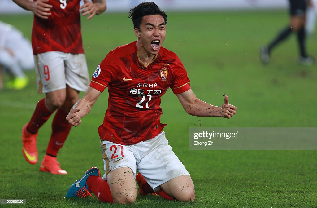 Zhao Xiaori of Guangzhou Evergrande celebrates the goal with teammates during the AFC Asian Champions League Group H match between Guangzhou...