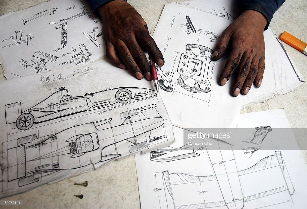 Zhao Xiuguo shows his blueprints of the homemade replica of Formula One car on October 27, 2006 in Tangshan, Hebei Province of China. Zhao Xiuguo and his brother Zhao Xiushun, who were educated to junior high school and run a small motorcycle repair shop, have built four homemade race cars from scrap metal during the past 10 years, which have spent all of their saving. They have been interested in race cars since childhood and dream of making the first Formula One race car in China after the F1 Grand Prix made its debut in Shanghai in 2004.