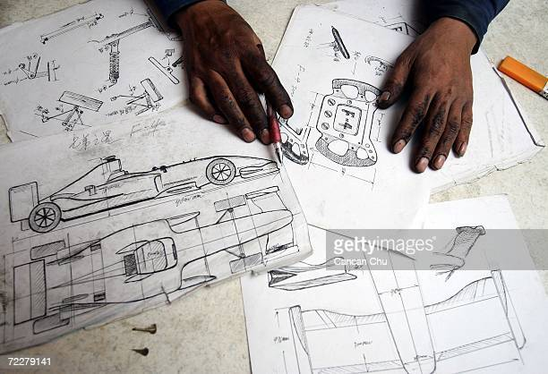 Zhao Xiuguo shows his blueprints of the homemade replica of Formula One car on October 27 2006 in Tangshan Hebei Province of China Zhao Xiuguo and...