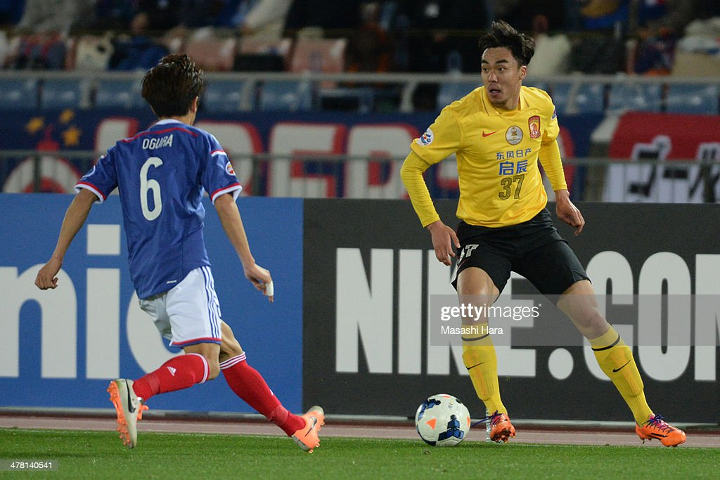 <a gi-track='captionPersonalityLinkClicked' href=/galleries/search?phrase=Zhao+Xuri&family=editorial&specificpeople=596391 ng-click='$event.stopPropagation()'>Zhao Xuri</a> #37 of Guangzhou Evergrande in action during the AFC Champions League Group G match between Yokohama F.Marinos and Guangzhou Evergrande at Nissan Stadium on March 12, 2014 in Yokohama, Japan.