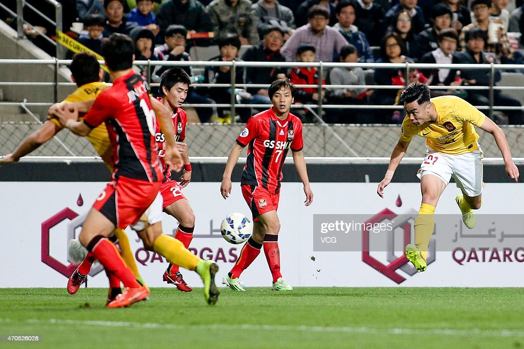 <a gi-track='captionPersonalityLinkClicked' href=/galleries/search?phrase=Zhao+Xuri&family=editorial&specificpeople=596391 ng-click='$event.stopPropagation()'>Zhao Xuri</a> #21 of Guangzhou Evergrande shoots the ball during the AFC Champions League Group H match between FC Seoul and Guangzhou Evergrande at Seoul World Cup Stadium on April 21, 2015 in Seoul, South Korea.