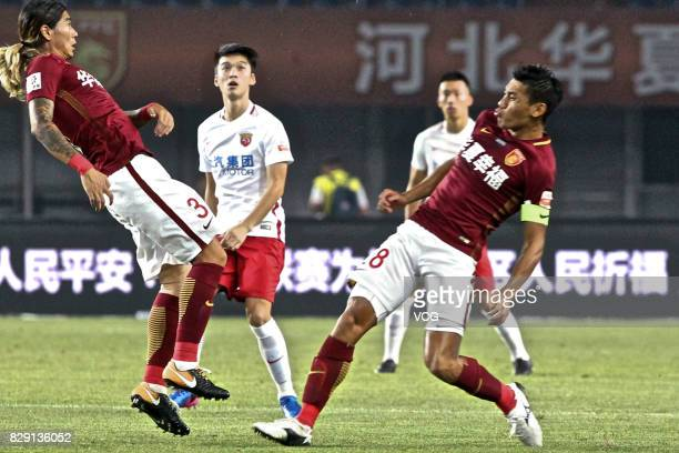Zhao Yuhao and Zhang Chengdong of Hebei China Fortune follow the ball during the 21st round match of 2017 China Super League between Hebei China...