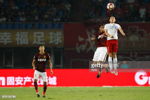 Zhao Yuhao of Hebei China Fortune and Wu Lei of Shanghai SIPG jump up the head the ball during the 21st round match of 2017 China Super League...