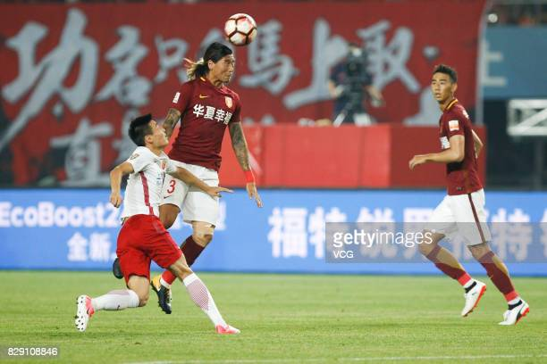 Zhao Yuhao of Hebei China Fortune heads the ball during the 21st round match of 2017 China Super League between Hebei China Fortune FC and Shanghai...