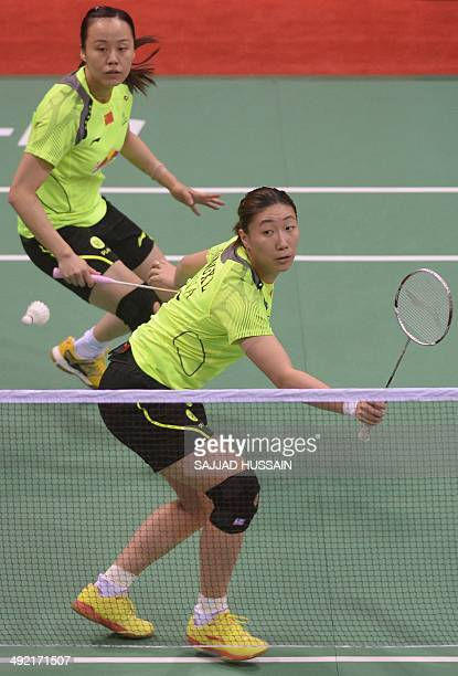 Zhao Yunlei and Wang Xiaoli of China play a return to Heather Olver and Kate Robertshaw of England during their Uber Cup badminton match at Siri Fort...