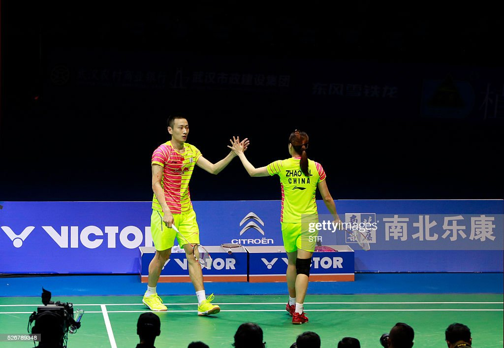 Zhao Yunlei (R) and Zhang Nan of China celebrate after winning a point during the mixed doubles final match against Tontowi Ahmad and Liliyana Natsir of India at the 2016 Badminton Asia Championships in Wuhan, central China's Hubei province on May 1, 2016. / AFP / STR / China OUT