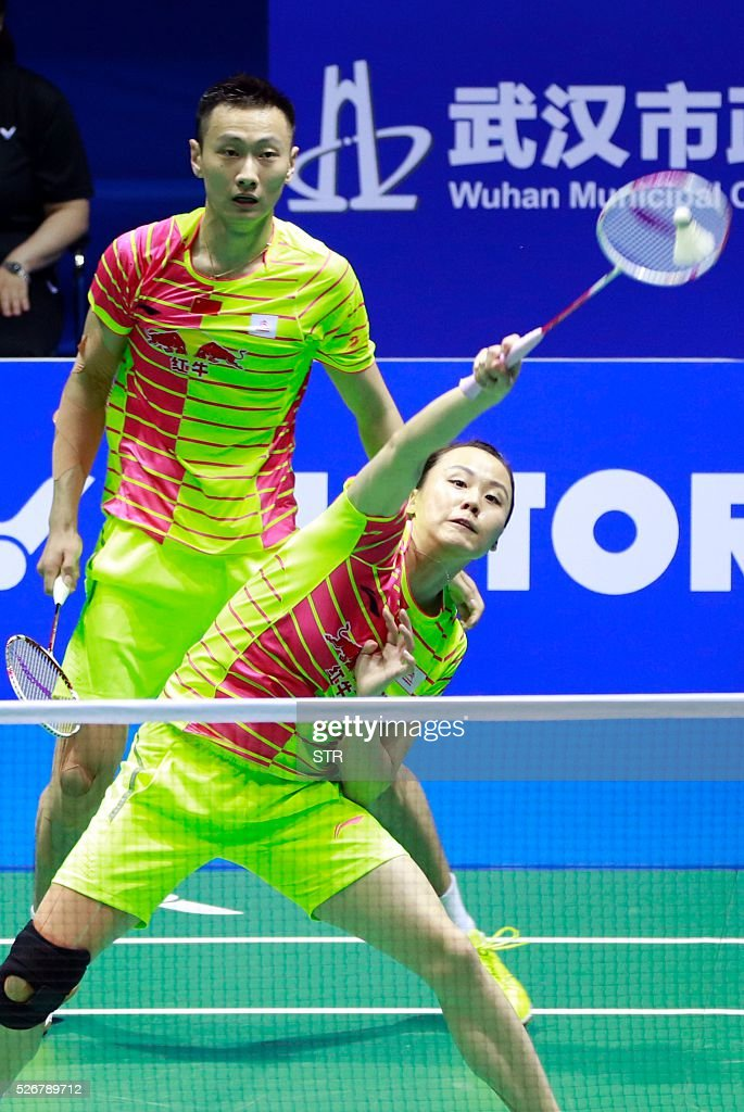 Zhao Yunlei (front) and Zhang Nan of China hits a return to Tontowi Ahmad and Liliyana Natsir of India during their mixed doubles final match at the 2016 Badminton Asia Championships in Wuhan, central China's Hubei province on May 1, 2016. / AFP / STR / China OUT