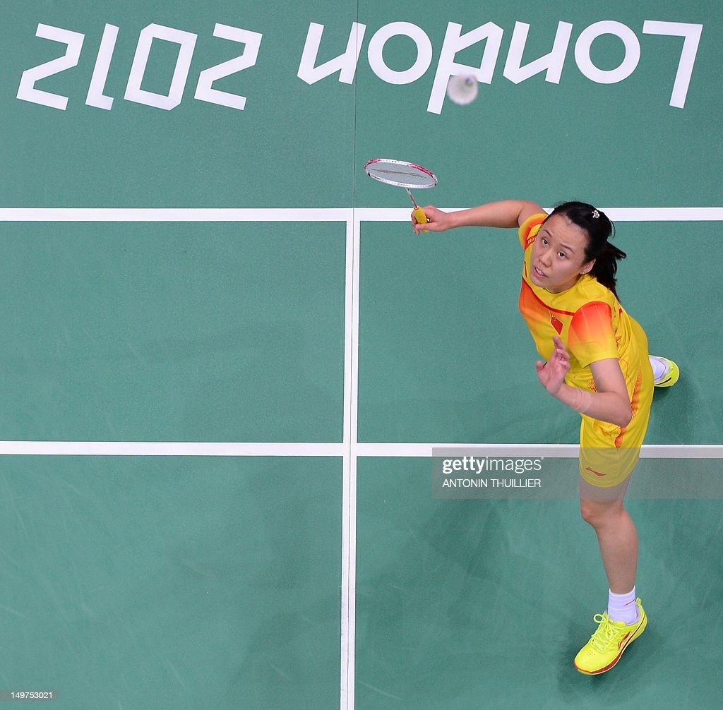 Zhao Yunlei of China prepares to play a smash in her mixed doubles final badminton match with Zhang Nan against compatriots Ma Jin and Xu Chen in London on August 3, 2012, for The 2012 London Olympic Games.