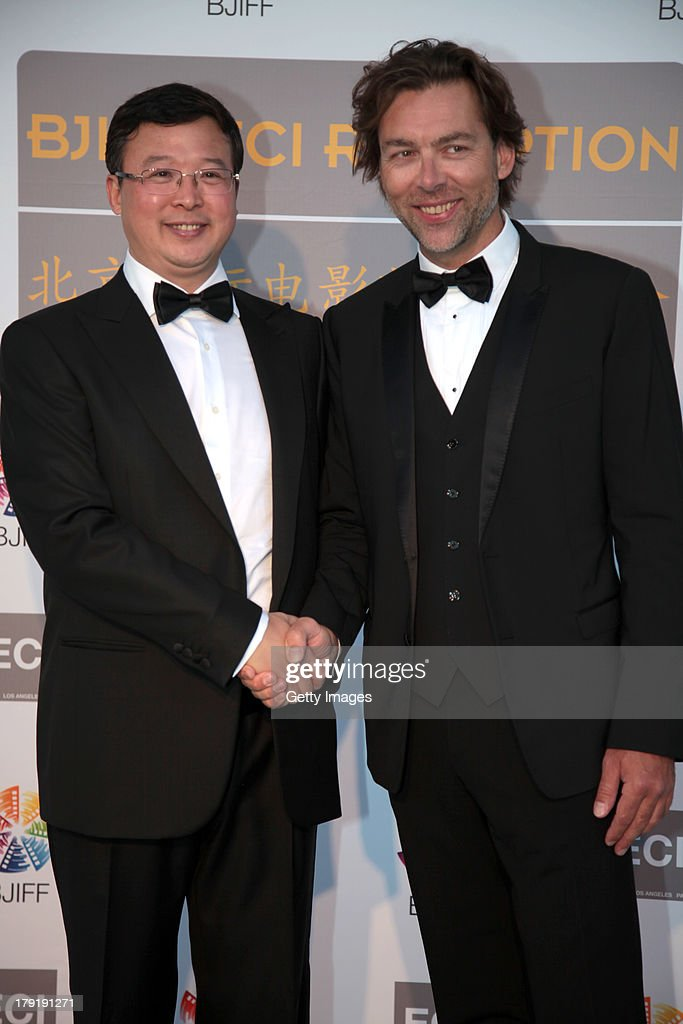 Zhao Zhiyong, Deputy Secretary-General of BJIFF Organizing Committee, and Vincent Fisher attend the Beijing International Film Festival (BJIFF) Organization Committee Reception during the 70th Venice International Film Festival at the Danieli Hotel - La Terrazza on August 31, 2013 in Venice, Italy.