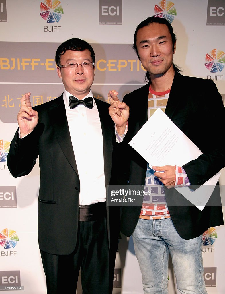 Zhao Zhiyong, Deputy Secretary-General of BJIFF Organizing Committee and Shi Yang Shi attend the Beijing International Film Festival (BJIFF) Organization Committee Reception during the 70th Venice International Film Festival at the Danieli Hotel - La Terrazza on August 31, 2013 in Venice, Italy.