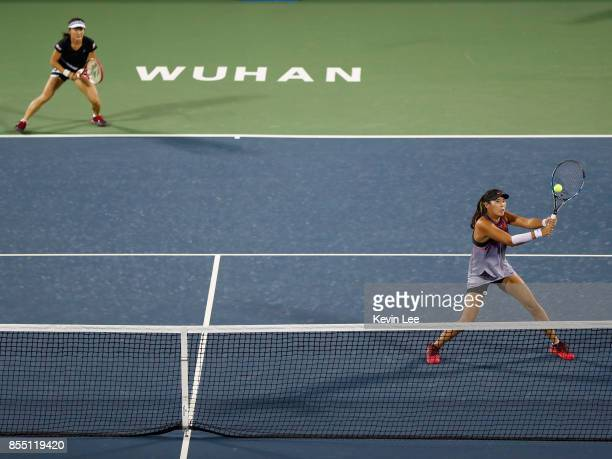 Zhaoxuan Yang of China returns a shot to Ekaterina Makarova of Russia and Elena Vesnina of Russia in a match between Shuko Aoyama of Japan and...