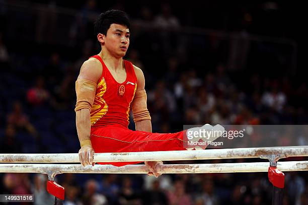 Zhe Feng of China competes on the parrallel bars during the Artistic Gymnastics Men's Parallel Bars final on Day 11 of the London 2012 Olympic Games...
