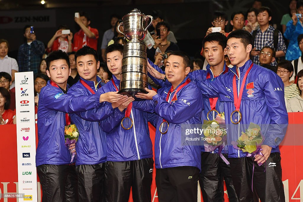 Zhendong Fan Hao Wang Long Ma Coach Guoliang Liu Jike Zhang and Xin Xu of team China pose with gold medal on the podium during day eight of the 2014...