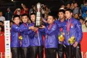 Zhendong Fan Hao Wang Long Ma Coach Guoliang Liu Jike Zhang and Xin Xu of team China pose with gold medal on the podium during day eight of the 2014...