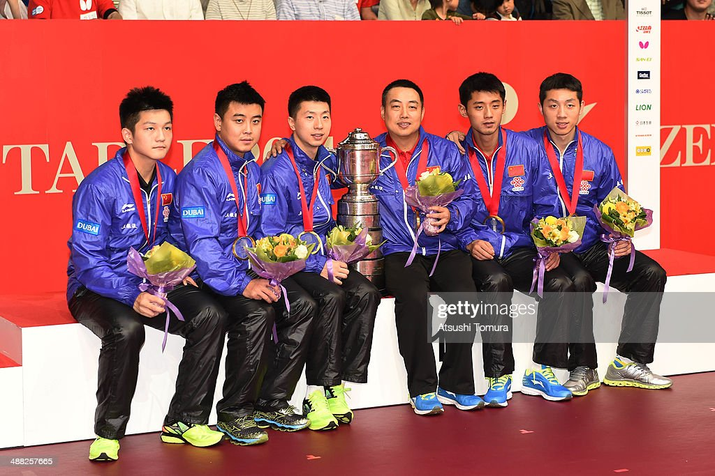 Zhendong Fan, Hao Wang, Long Ma, Coach Guoliang Liu, Jike Zhang and Xin Xu of team China pose with gold medal on the podium during day eight of the 2014 World Team Table Tennis Championships at Yoyogi National Gymnasium on May 5, 2014 in Tokyo, Japan.