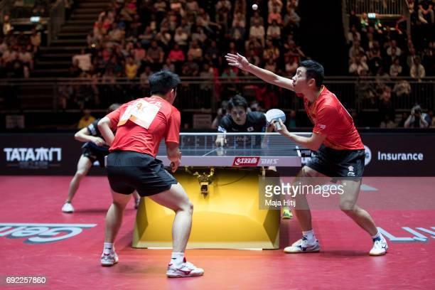 Zhendong Fan of China and Xin Xu of China in action against Masataka Morizono of Japan and Yuya Oshima of Japan during Men's Doubles Final at Table...
