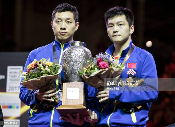 Zhendong Fan of China and Xin Xu of China pose with a trophy during celebration ceremony of Men's Doubles at Table Tennis World Championship at at...