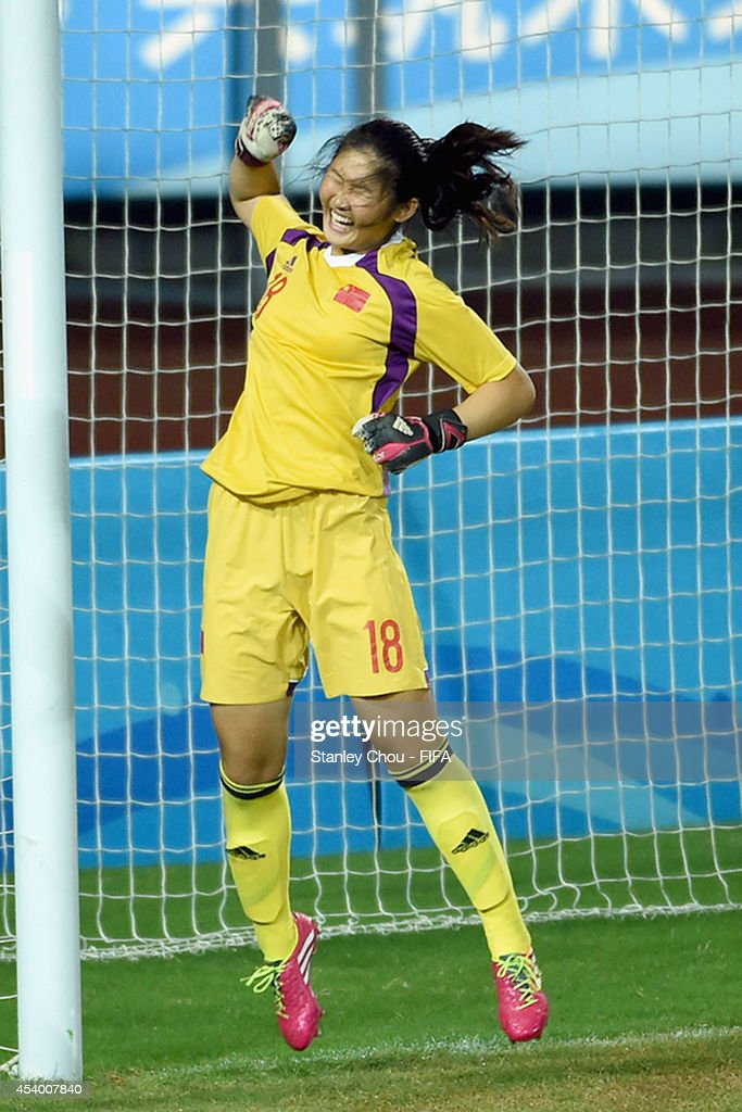 Zheng Jie of China celebrates after she saved a penalty in the penalty shoot out after the full time scorelss draw during the 2014 FIFA Girls Summer Youth Olympic Football Tournament Semi Final match between China and Slovkia at Wutaishan Stadium on August 23, 2014 in Nanjing, China.