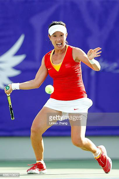 Zheng Jie of China returns a shot during the Women's Team Gold Medal Match against Hsieh Su Wei of Chinese Taibei on day five of the 2014 Asian Games...