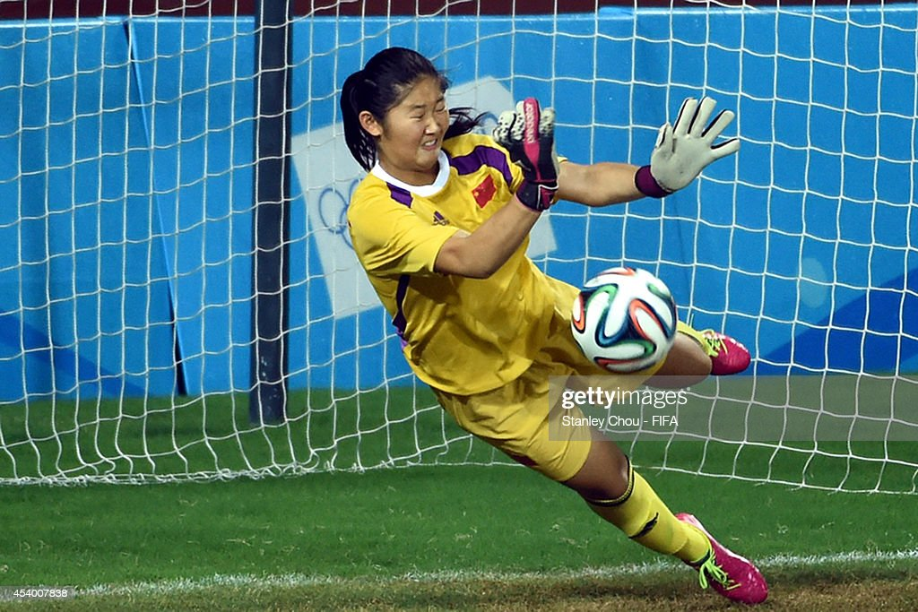 Zheng Jie of China saves a penalty in the penalty shoot out after the full time scorelss draw during the 2014 FIFA Girls Summer Youth Olympic Football Tournament Semi Final match between China and Slovkia at Wutaishan Stadium on August 23, 2014 in Nanjing, China.