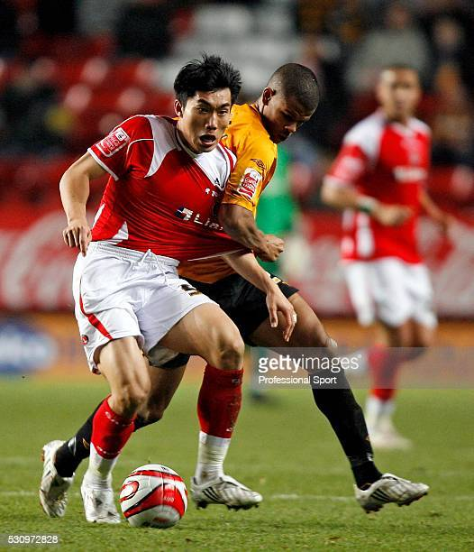 Zheng Zhi of Charlton and Fraizer Campbell of Hull City in action during the Charlton v Hull Championship Match at The Valley Stadium London UK on...