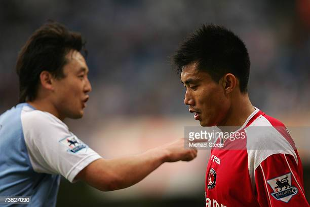 Zheng Zhi of Charlton Athletic looks on as Jihai Sun of Manchester City gestures during the Barclays Premiership match between Manchester City and...