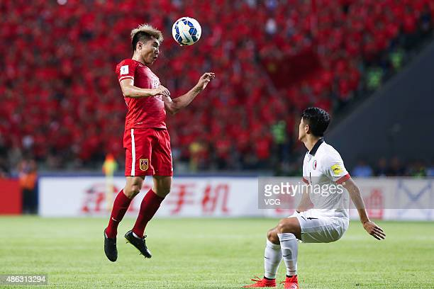 Zheng Zhi of China heads the ball during a group match between China and Hong Kong as a part of 2018 FIFA World Cup qualification at Shenzhen Bao'an...
