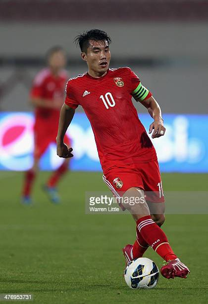 Zheng Zhi of China in action during the Asian Cup Qualification match between China and Iraq at the AlSharjah Stadium on March 5 2014 in Sharjah...