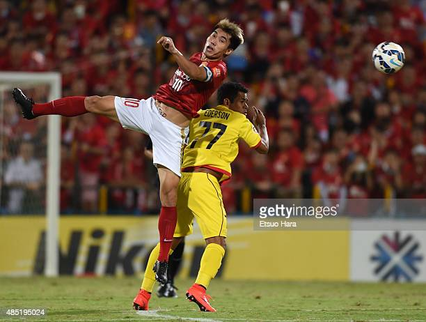 Zheng Zhi of Guangzhou Evergrande and Ederson of Kashiwa Reysol compete for the ball during the AFC Champions League quarter final first leg match...