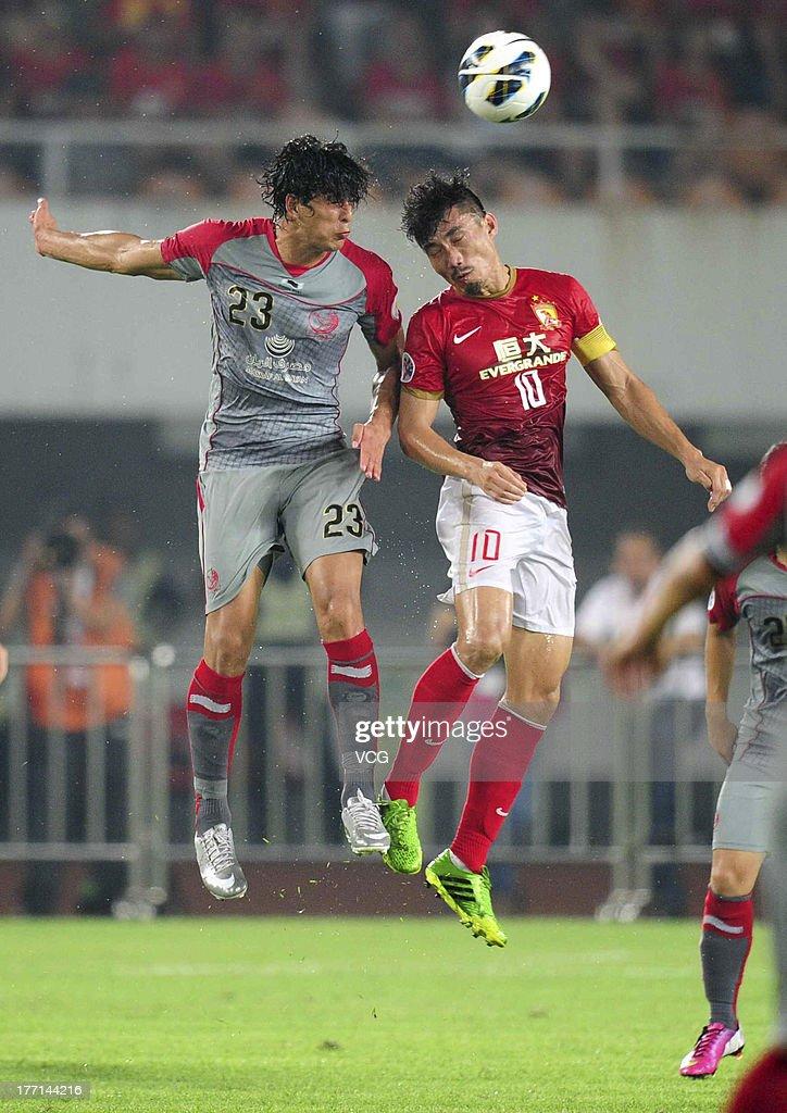Zheng Zhi of Guangzhou Evergrande and Sebastian Soria of Lekhwiya battle for the ball during the AFC Champions League quarterfinal match between...