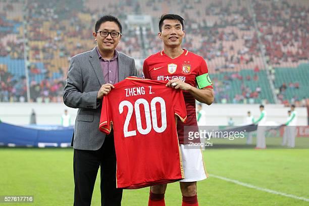 Zheng Zhi of Guangzhou Evergrande celebrates his 200 matches for Guangzhou Evergrande with Liu Yongzhuo of Guangzhou Evergrande during the AFC Asian...