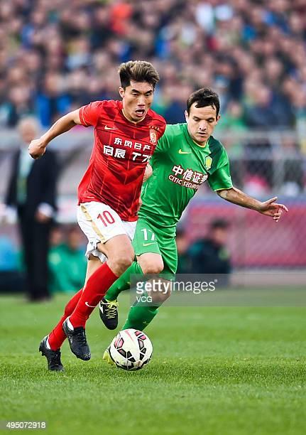 Zheng Zhi of Guangzhou Evergrande competes for the ball with Pablo Batalla of Beijing Guoan in the match between Beijing Guoan and Guangzhou...