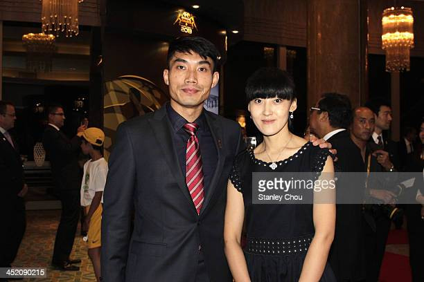 Zheng Zhi of Guangzhou Evergrande FC of China poses with his wife prior to the start of the 2013 AFC Annual Awards at the Mandarin Oriental on...