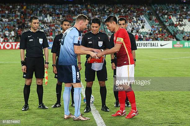 Zheng Zhi of Guangzhou Evergrande swaps pennants with Shane Smeltz of Sydney FC during the AFC Champions League Group H match between Sydney FC and...