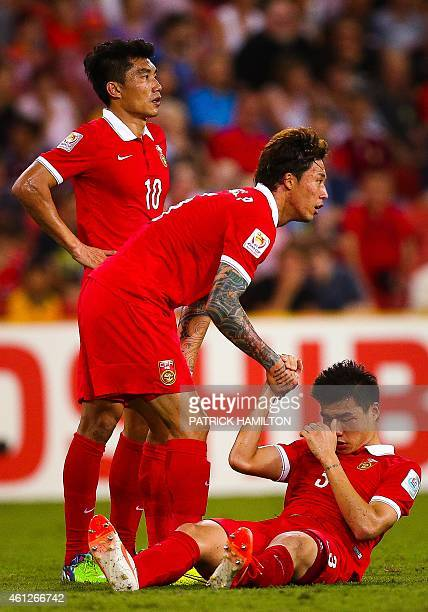Zheng Zhi Zhang Linpeng and Mei Fang of China during the first round Asian Cup football match between China and Saudi Arabia at the Suncorp Stadium...