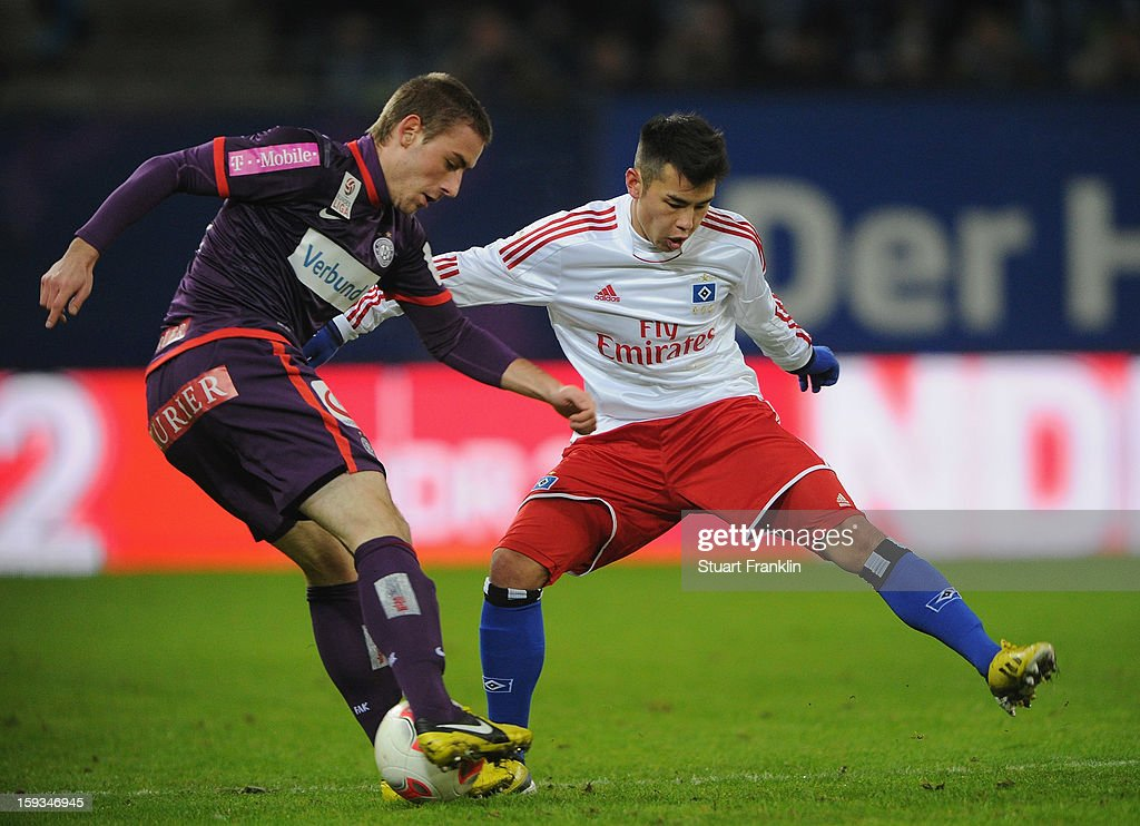 Zhi Gin Lam of Hamburg challenges for the ball with Remo Mally of Vienna during the international friendly match between Hamburger SV and Austria Wien at Imtech Arena on January 12, 2013 in Hamburg, Germany.