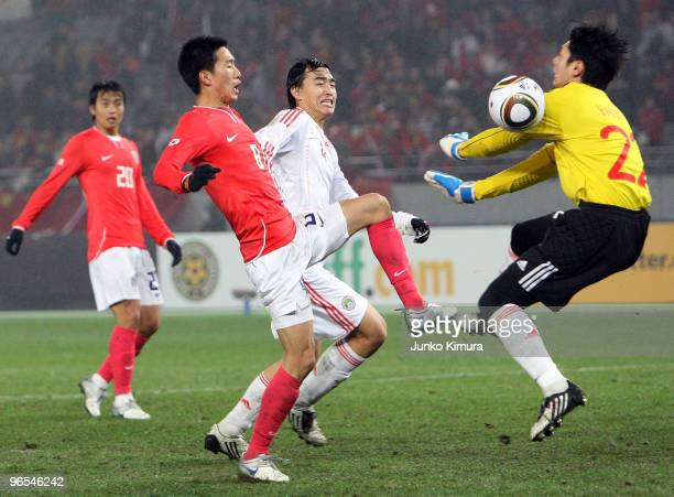 Zhi Yang of China and Jung Woo Kim of South Korea compete for the ball during the East Asian Football Championship 2010 match between China and South...