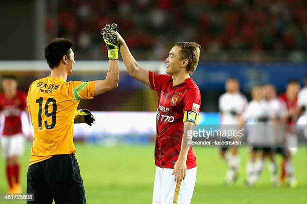 Zhi Zhang of Guangzhou celebrates with his team mate Cheng Zeng the international friendly match between FC Guangzhou Evergrande Taobao FC and FC...