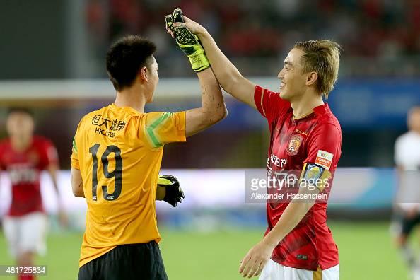 Zhi Zhang of Guangzhou celebrates with his team mate Cheng Zeng the international friendly match between FC Guangzhou Evergrande Taobao FC and FC...