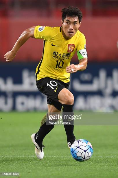 Zhi Zheng of Guangzhou Evergrande in action during the AFC Champions League Round of 16 match between Kashima Antlers and Guangzhou Evergrande FC at...