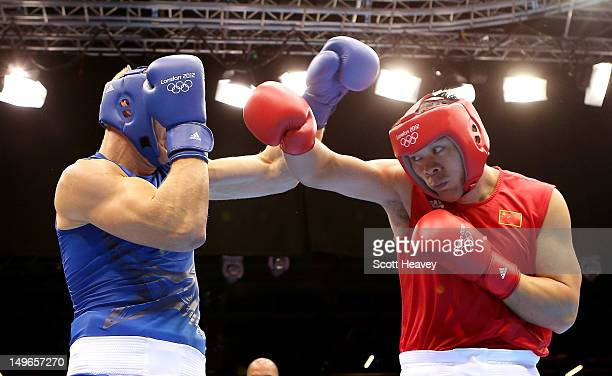 Zhilei Zhang of China in action with Johan Linde of Australia during the Men's Super Heavy Boxing on Day 5 of the London 2012 Olympic Games at ExCeL...