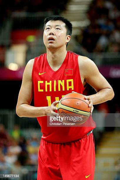 Zhizhi Wang of China prepares to throw a free throw shot against Australia in the second half during the Men's Basketball Preliminary Round match on...